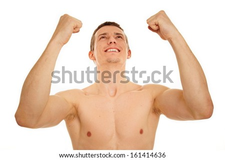 athletic young man shirtless shows enthusiasm with hands up over head