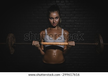 Athletic young woman doing a fitness workout with weights - stock photo