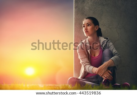 Athletic young woman running in the nature. Girl resting after an active fitness training. Healthy lifestyle.  - stock photo