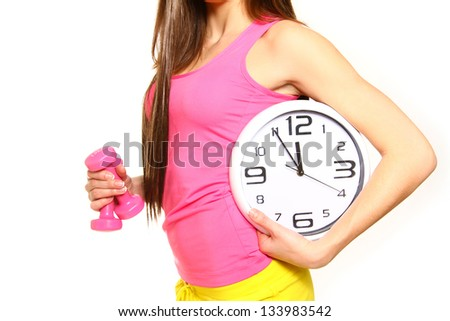 Athletic young woman with a clock and dumbbells on a white background - stock photo