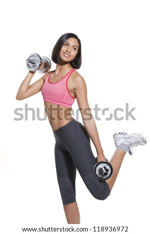 athletic young woman with barbells during workout. on white background - stock photo