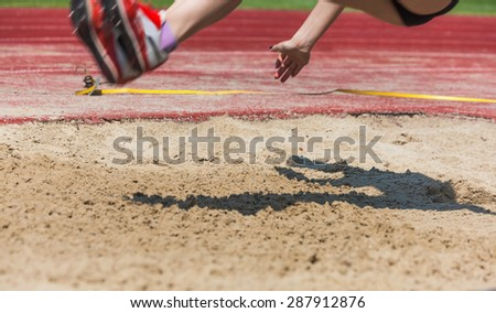 athletics competitions in long jump at the finish - stock photo
