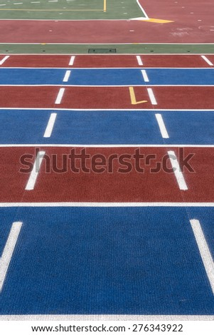 Athletics running track with number 1. Straight line of a Running Track. Blue, red, white and green colors.