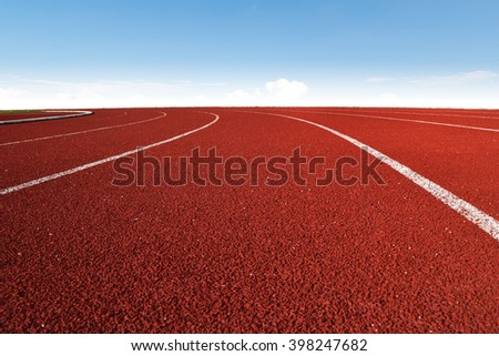 Athletics Stadium Running track curve and blue sky  - stock photo