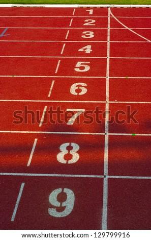 Athletics track in stadium - stock photo