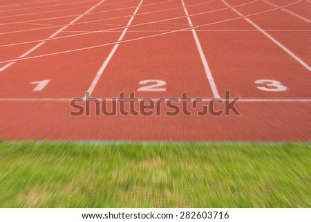 Athletics Track Lane no. 1-3 with grass field - stock photo