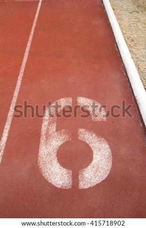 Athletics Track Lane Number six - stock photo