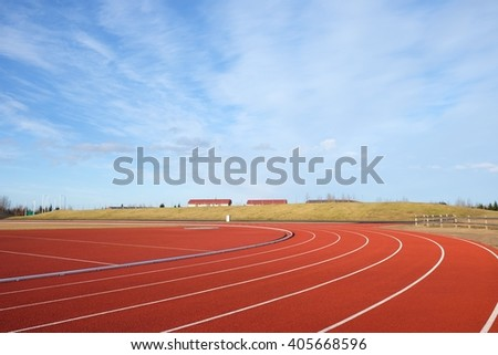 athletics track with blue sky - stock photo