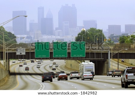 Atlanta cityscape with blank road signs.  Taken on a hazy day on the Labor Day weekend. - stock photo