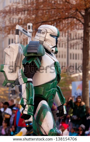 ATLANTA, GA - DECEMBER 1:  A character from the Star Wars movies walks down Peachtree Street while taking part in the annual Atlanta Christmas parade on December 1, 2012 in Atlanta, GA. - stock photo