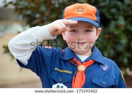 ATLANTA, GA -- FEB. 8: An unidentified Cub Scout gives the Boy Scout salute during an outdoor  event on Feb. 8, 2014. More than 1.1 million children in the U.S. participated in outdoor Scouting activities in 2013 . - stock photo