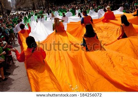 ATLANTA, GA - MARCH 15:  People form a human flag of Ireland at the St. Patrick's parade on Peachtree Street, on March 15, 2014 in Atlanta, GA.  - stock photo