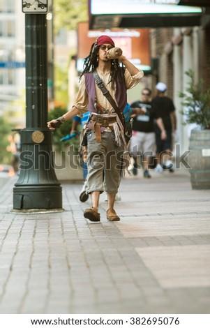 ATLANTA, GA - SEPTEMBER 5:  A man dressed like Captain Jack Sparrow from the Pirates of the Caribbean movies, walks down Peachtree Street on September 5, 2015 in Atlanta, GA.   - stock photo