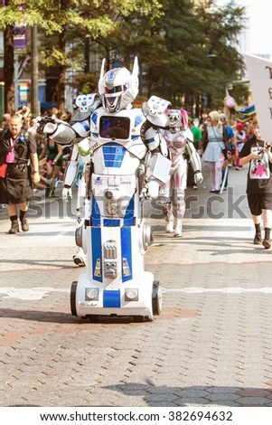 ATLANTA, GA - SEPTEMBER 5:  A person dressed as a mobile robot takes part in the annual Dragon Con parade on Peachtree Street September 5, 2015 in Atlanta, GA.  - stock photo