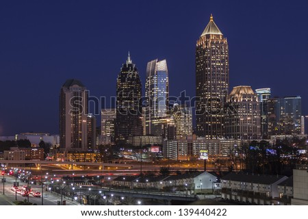ATLANTA, GEORGIA - FEB 14, 2011:  Dusk photo of homes and towers in Atlanta's fast changing Midtown area on February 14, 2011 in Atlanta, Georgia USA. - stock photo
