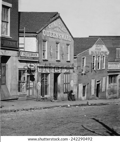 Atlanta, Georgia, slave auction house during Union General Sherman's occupation in September-October 1864. A Union soldier sits in front of the building. Photo by George N. Barnard. - stock photo