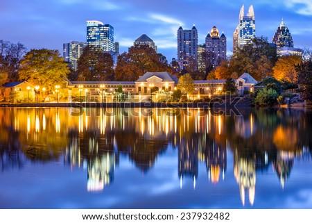Atlanta, Georgia, USA downtown city skyline at Piedmont Park's Lake Meer. - stock photo