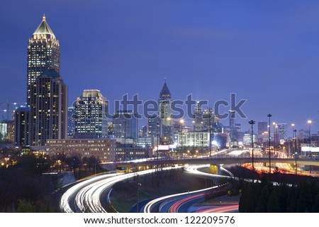 Atlanta. Image of Atlanta skyline and busy highway at night. - stock photo