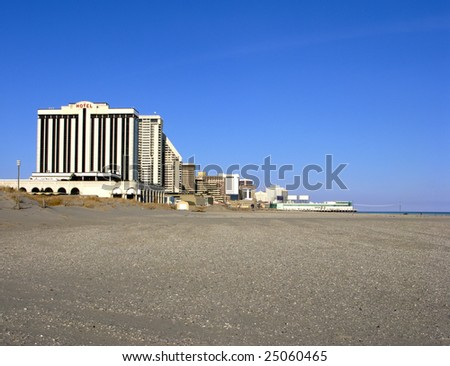 Atlantic City New Jersey cityscape view of casinos and hotels on the south end of the Boardwalk from the empty sandy beach in Ventnor - stock photo