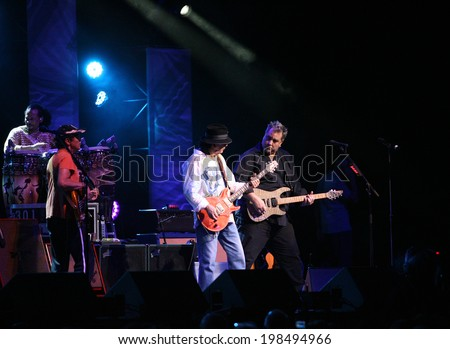 ATLANTIC CITY, NJ - JUNE 13: Musician Carlos Santana (C) performs with Tommy Anthony (R) and the rest of the Santana band at The Borgata Hotel & Casino on June 13, 2014 in Atlantic City, NJ.  - stock photo
