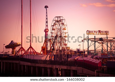 ATLANTIC CITY, NJ - SEPT 22:  View of Steel Pier amusement park rides in Atlantic City, NJ seen on the evening of Sept 22, 2013.  This historic amusement pier opened in 1898.  - stock photo