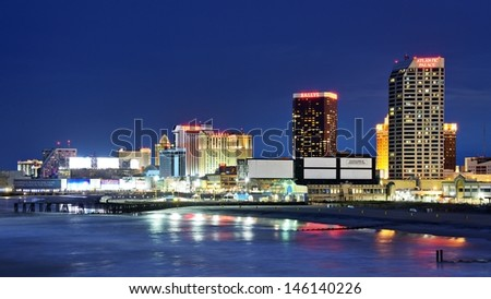 ATLANTIC CITY, NJ -  SEPTEMBER 8: The Boardwalk September 8, 2012 in Atlantic City, New Jersey. Gambling was legalized in the city in 1976 and led to a resurgence. - stock photo