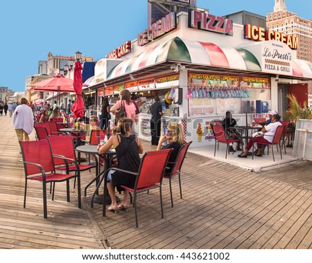 ATLANTIC CITY, NJ - SEPTEMBER 22, 2013: View of food concession stand along the boardwalk at Atlantic City with people visible.