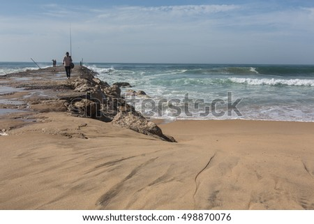 Atlantic coast in Costa de Caparica. Autumn day in Almada, Portugal.