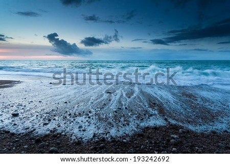 Atlantic ocean beach at dusk, Normandy, France - stock photo
