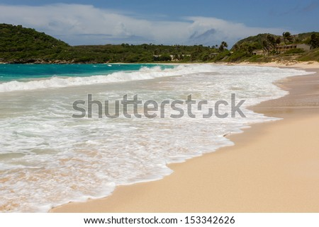 Atlantic Waves Crashing on Beach at Half Moon Bay Antigua - stock photo