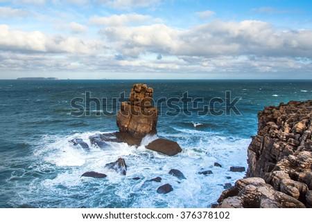 Atlantic waves on cliffs near Peniche, Portugal. - stock photo