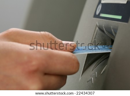 ATM inserting a card - stock photo