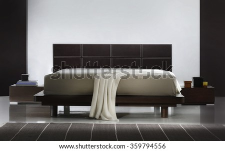 ATMOSPHERIC BEDROOM INTERIOR . BROWN LEATHER BED . - stock photo