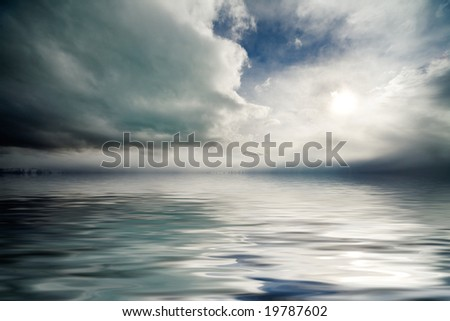Atmospheric cloudy storm sky over rippling lake