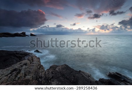 Atmospheric coastal sunset at Clachtoll Bay in the Scottish Highlands. - stock photo