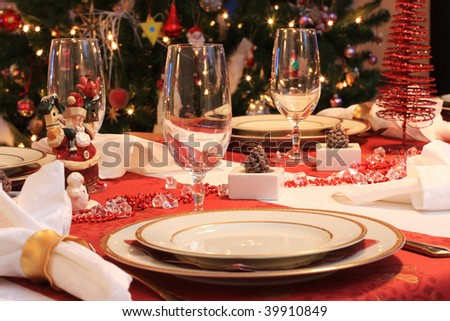 Atmospheric picture of a table set for christmas dinner - stock photo