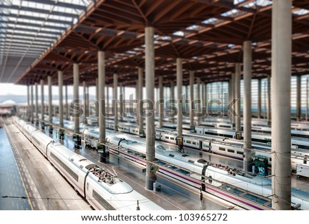 Atocha Madrid train station terminal. Modern station building with modern trains. Tilt shift effect. Madrid, Spain, Europe. - stock photo