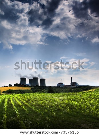 Atomic power station and field - stock photo