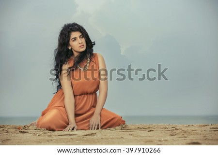 Atractive Indian young woman relaxing at beach - stock photo