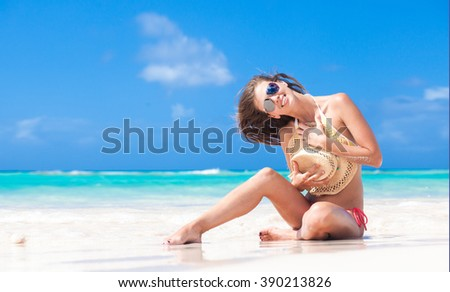 atrractive long haired woman relaxing at tropical beach