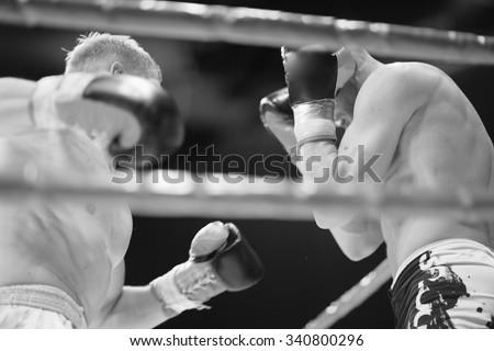 Attack and defense strategy in MMA,monochrome - stock photo