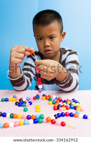 Attention Deficit Hyperactivity Disorder or  ADHD children are practicing beads.