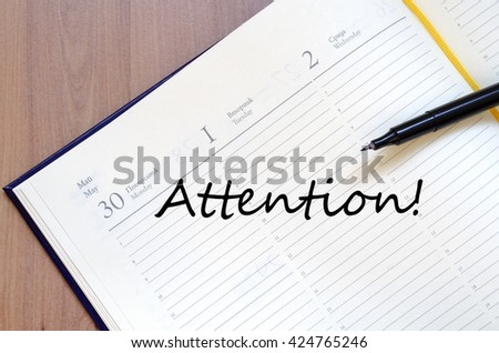 Attention text concept write on notebook