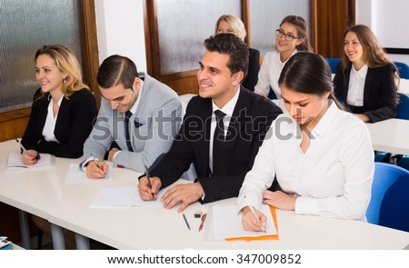 Attentive adult business students at the desks in classroom. Selective focus