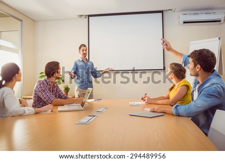 Attentive businessman asking a question in a meeting at office - stock photo