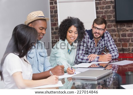 Attentive creative business team in meeting at office - stock photo