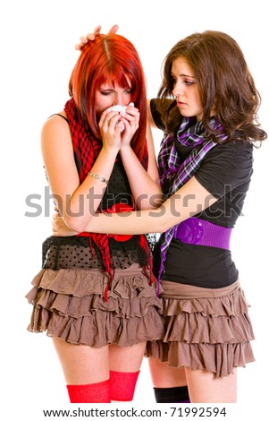Attentive young girl calming her sad girlfriend isolated on white - stock photo