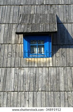 attic windows on wooden roof - stock photo