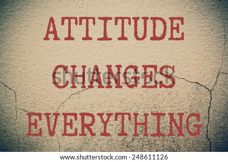 Attitude Changes Everything Concept write on wall  - stock photo
