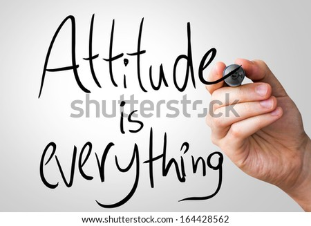Attitude is everything hand writing with a black mark on a transparent board - stock photo